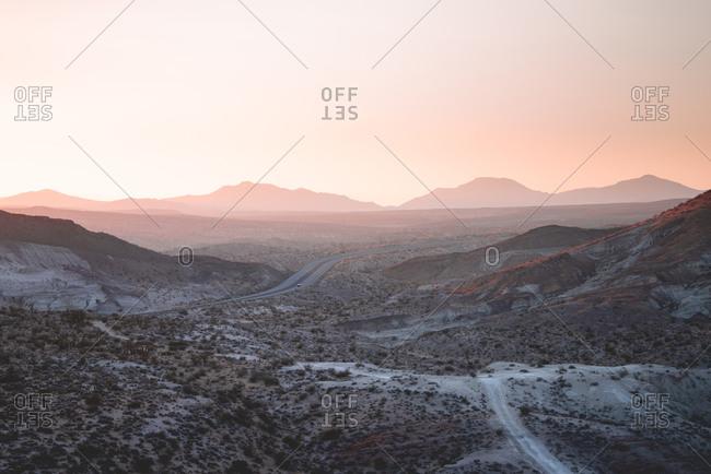 Desert highway under pastel sunset
