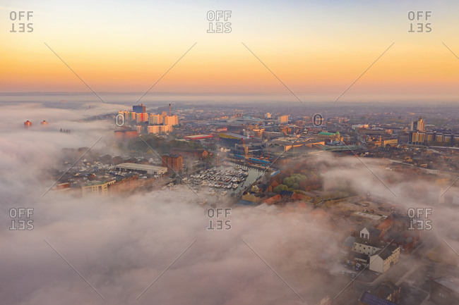 Aerial view of Hull skyline and the marina quay with fog at sunset, United Kingdom.
