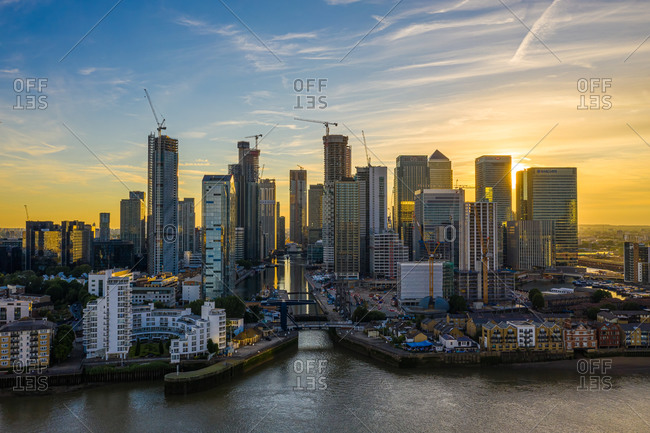 Aerial view of Canary Wharf financial district along the River Thams in London at sunset, United Kingdom.