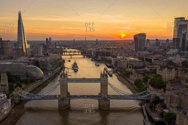 Aerial view of the Tower Bridge and the Shard building with London skyline at sunset, United Kingdom.