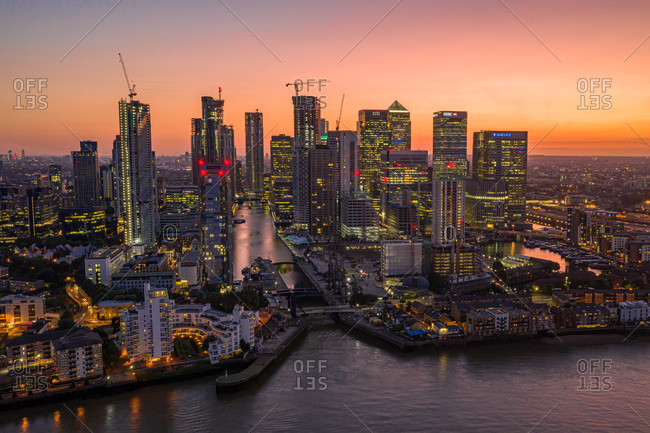 July 22, 2019: London, United Kingdom29 December 2020: Aerial view of Canary Wharf skyscrapers and London financial district along the Thames river at sunset.