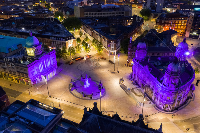 Aerial view of Queen Victoria square with purple light at night in Hull city center, United Kingdom.