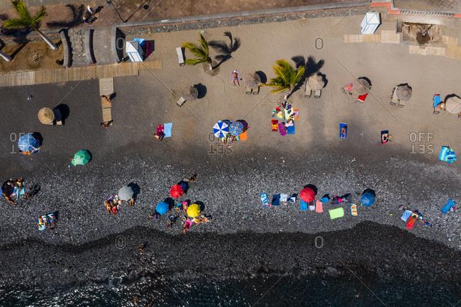 Aerial view of black sanding volcanic beach in Playa San Juan, Tenerife, Canary islands, Spain.
