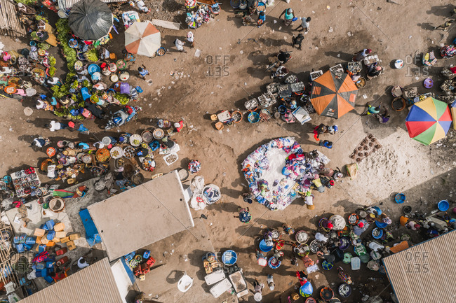 Aerial view of traditional city market with people in Tombo city, Western Area, Sierra Leone.