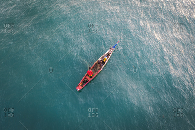 Aerial view of African fisherman on a traditional fishing boat in Western Area, Sierra Leone.