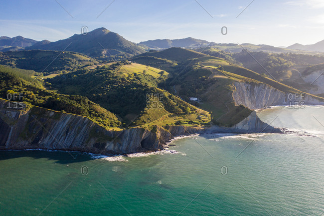 Aerial view of white cliffs on Sekoneta beach facing the Atlantic Ocean in Deba, Euskadi, Spain.