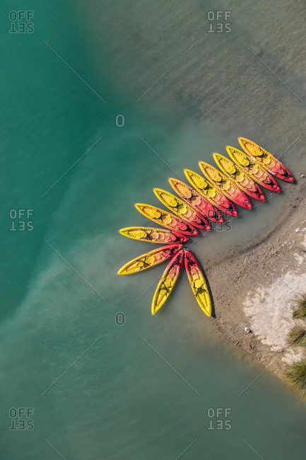 Aerial view of a small and colorful group of Kayak in Cardener lake near the city of Guixers in Catalonia, Spain.