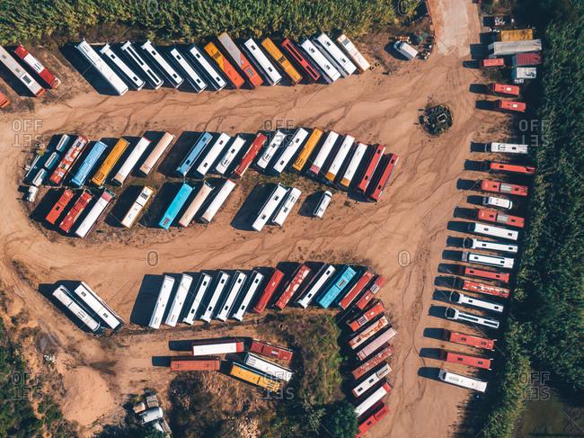 Aerial view of a parking lot full of touristic buses near Lloret de Mar, Spain.