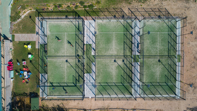 Aerial view of two people playing paddle in a tennis court at Papalus Golf club, Catalonia, Spain.
