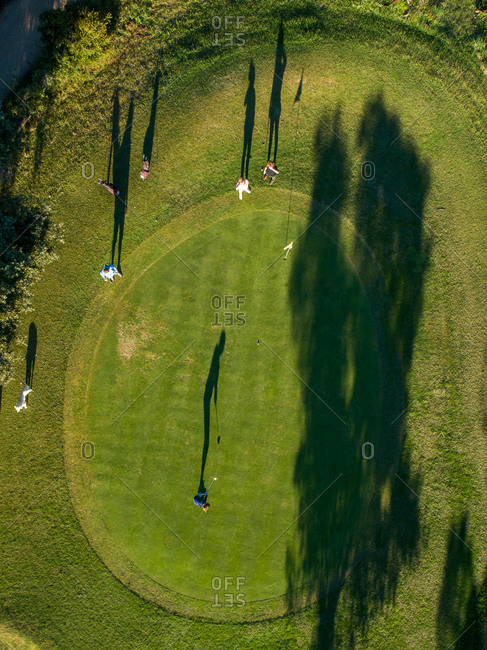 Aerial view of a group of people playing Golf in Lloret de Mar golf club, Catalonia, Spain.