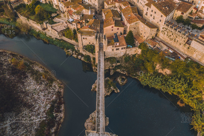 Aerial view of Pont de Besalu medieval bridge crossing the El Fluvia river in Besalù, Girona, Spain.