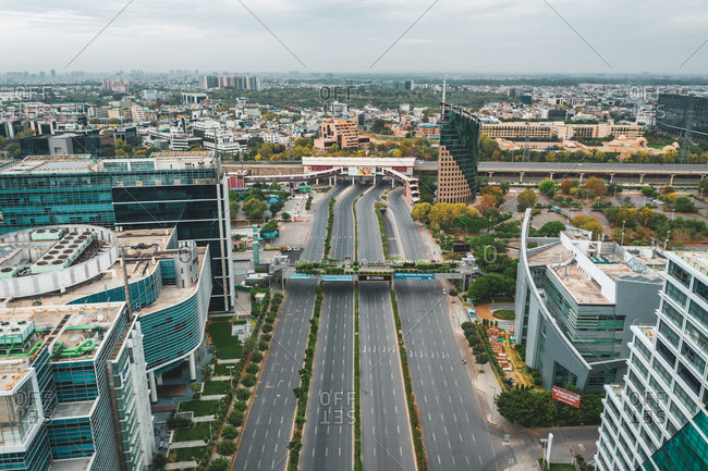 April 17, 2020: Aerial view of Gurugram district with buildings and an empty suspended highway near the city of New Delhi in Haryana state during lockdown, India.