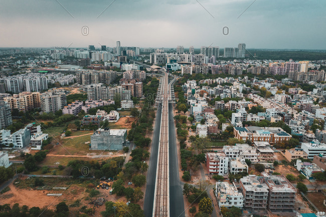 Aerial view of Gurugram district with buildings and an empty suspended highway near the city of New Delhi in Haryana state during lockdown, India.