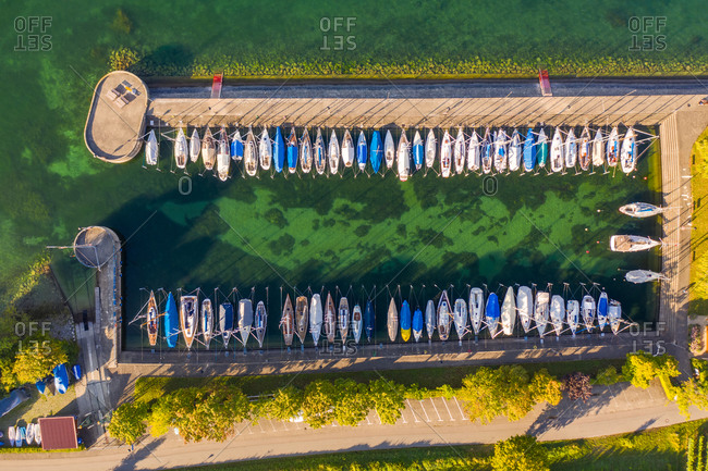 Aerial view of a harbor on Constance lake with boats in Meersburg, Baden-Wurttemberg, Germany.
