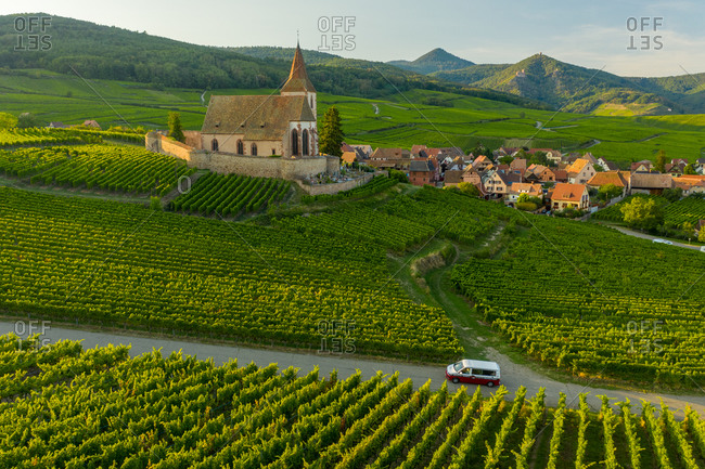 September 13, 2020: Hunawihr, France12 September 2020: Aerial view of a camper van driving near the little village of Hunawihr in Haut-Rhin, France.