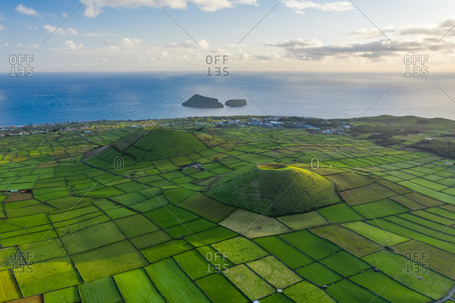 Aerial view of two volcanoes with plantation field on Terceira Island, the Azores, Portugal.