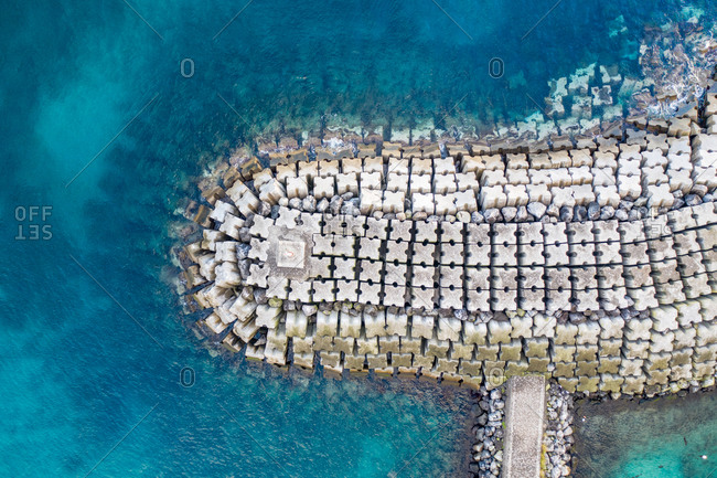 Aerial view of the breakwater at St. Mateus harbor on Terceira island. Azores archipelagos, Portugal.