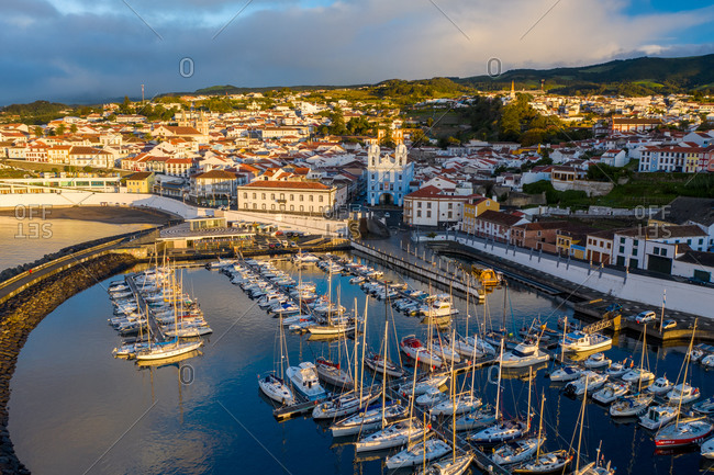 Aerial view of the Saint Mateus fishing harbor at sunset on Terceira Island. Azores archipelagos, Portugal.