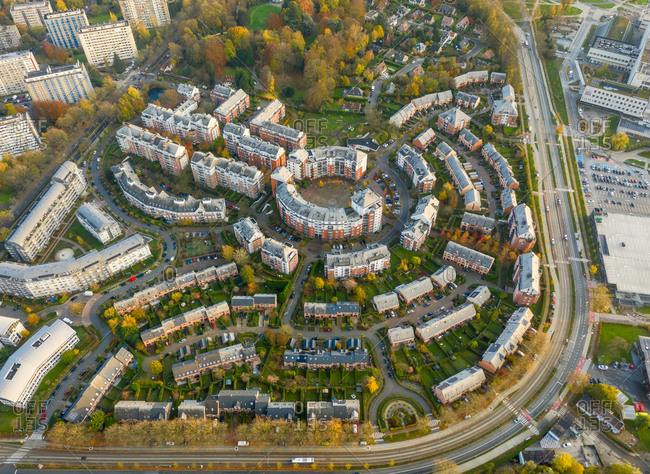 Aerial view of the residential district in Brussel, Belgium. Scattered building in a geometric shape formation surrounded by vegetation.