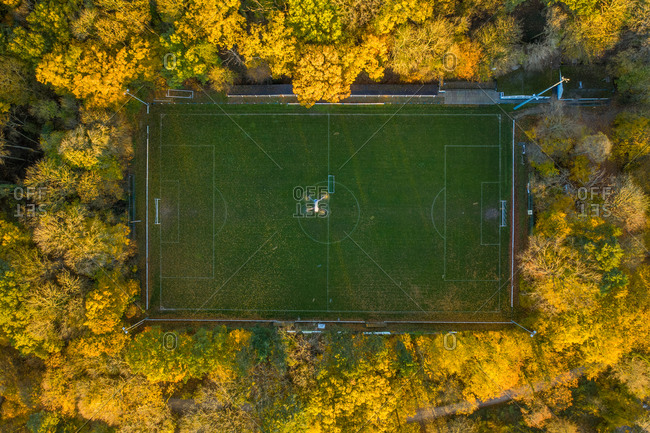 Aerial view of a drone flying over a football field.