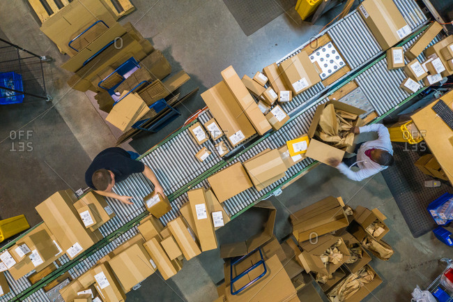 April 17, 2019: Chicago, Illinois17 April 2019: Aerial view of people working in team and packing with boxes in a logistic factory.