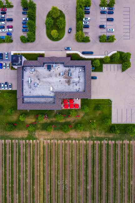 Aerial view of a small parking lot next to the vineyard near the Lake Ontario, Canada.