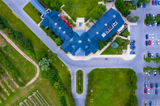 Aerial view of a restaurant building from the top near a vineyard in Ontario, Canada.