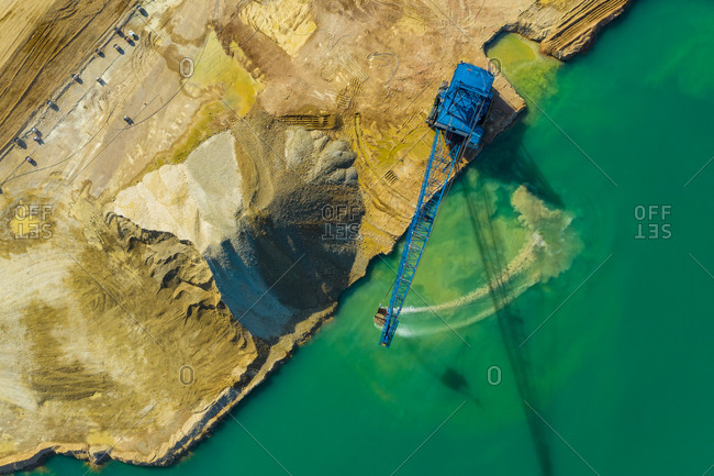 Aerial view of a blue crane operating on a quarry in Blackberry Township in Illinois, United States of America.