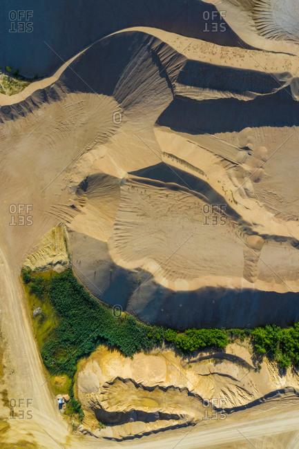 Aerial view of the sandy shapes of a quarry in Blackberry Township, Illinois, United States of America.