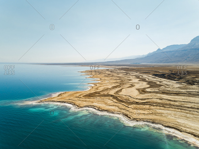 Aerial view of the texturized expanding shoreline in the Dead sea as the water level decreases. Negev, Israel.