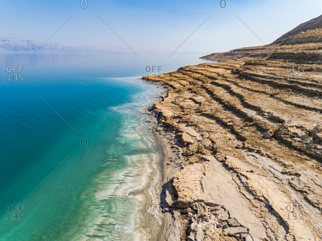 Aerial view of the Dead sea and its growing shoreline as the water level drop rapidly. Jordan Rift Valley, Israel.