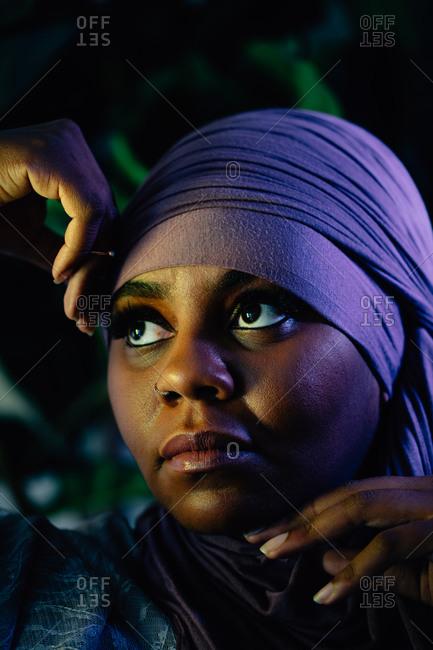Creative portrait of Black and beautiful Muslim woman, Moody