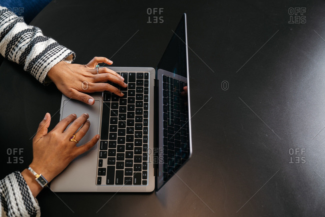 Top view of an Indian female lawyer working on her computer