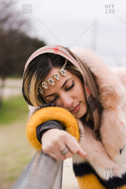 Portrait of a Muslim woman posing wearing jewelry and a fur coat