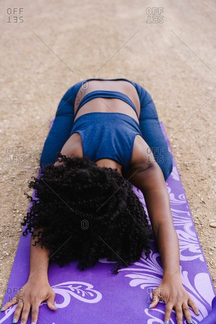 Vertical portrait of a woman performing yoga outdoors