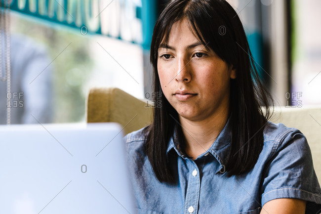 Hispanic woman using the computer