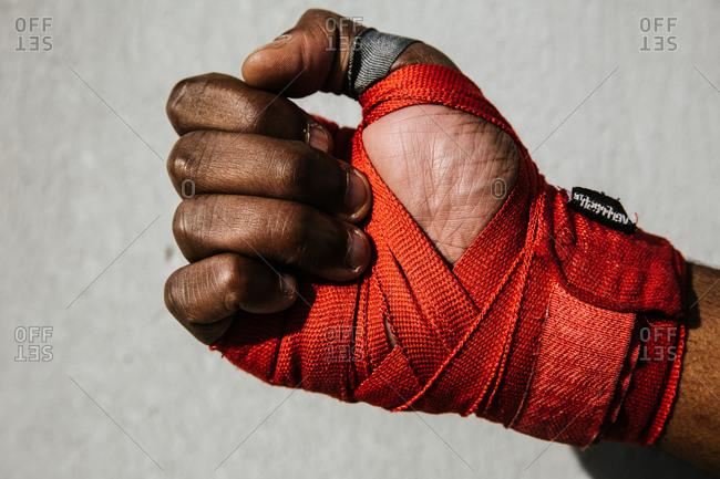 Close up shot of a hand wrapped in boxing wraps