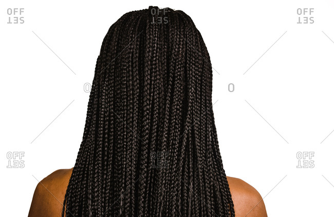 A back shot  of a Black woman showing off her long braided hair style