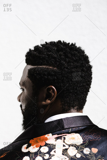 A side profile close up shot of a black man's hair from behind