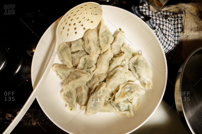 Top view of steamed chicken dumplings kept on a white plate