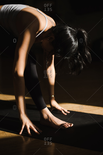 Young woman performing yoga in a studio