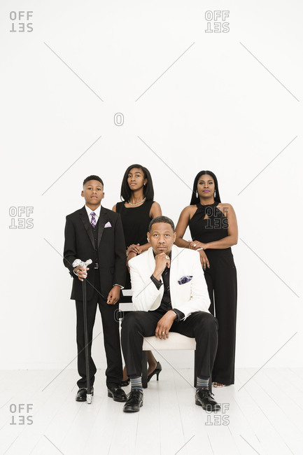 Family portrait of black couple and their two teen children dressed in formalwear