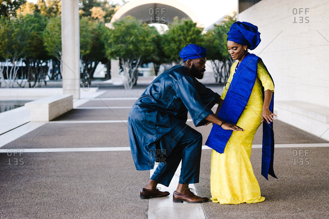 Horizontal portrait of an african couple dancing outside with copy space