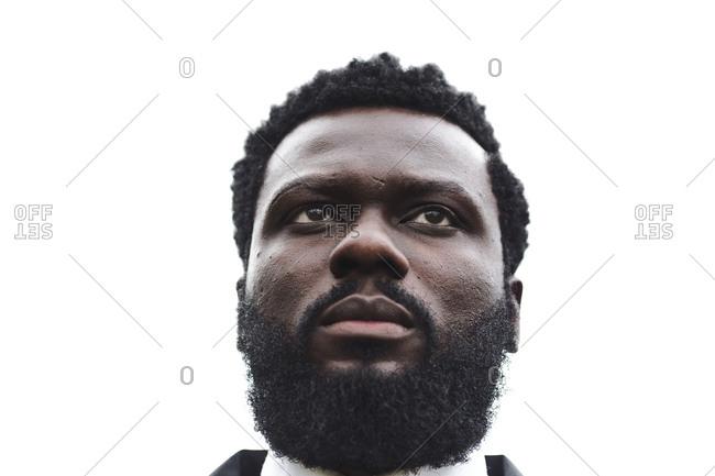 A closeup shot of a serious black man with a beard