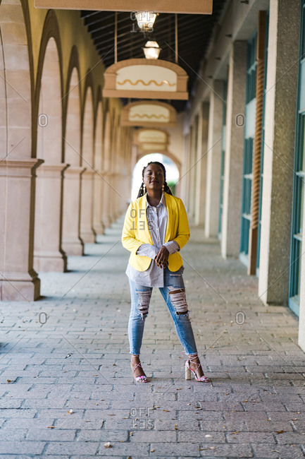 Stylish young girl posing in a hallway with confidence