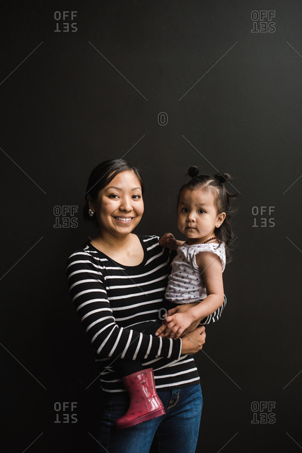 Portrait of a mother holding her daughter on her hip