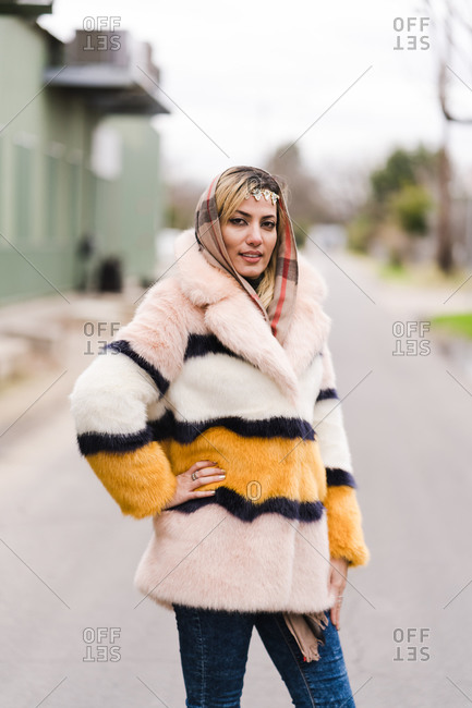 Stylish Muslim woman posing in a fur coat