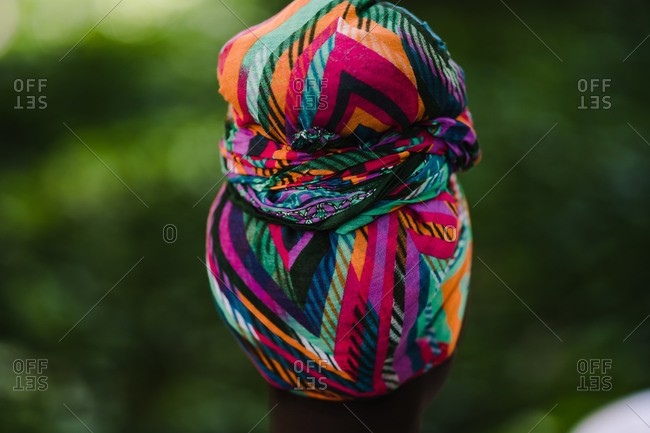 A close up back shot of a colorful headwrap