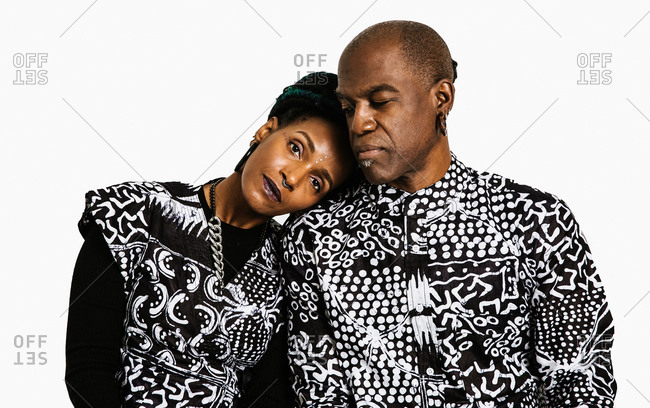 A medium shot of a black couple in matching african clothing