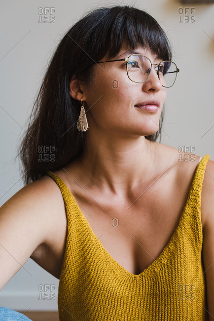 Close up of a beautiful young mixed race woman sitting in her home and posing